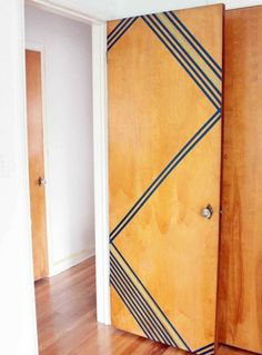 Door Design: If you're over your plain, flat door, transform it into an art piece with a little tape. (via Crab and Fish)