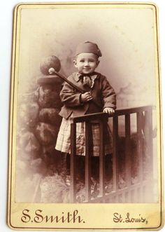 Dated 1892 Cabinet Photo Child Smiling Wearing Hat with Tassel & Holding Interesting Toy