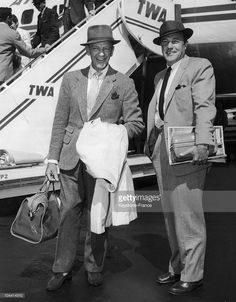 Fred ASTAIRE and Gene KELLY coming off the plane from Los Angeles at Idlewild Airport, near New York, between 1950 and 1955.