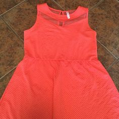 Peach/Coral Dress This is super comfortable and has some stretch it it! This dress would be perfect for summer because it is light and airy. This goes slightly above my knees. Xhilaration Dresses Midi
