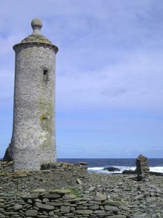 Old lighthouse beacon tower, North Ronaldsay. Further north than the southern tip of Norway, but with a mild climate, North Ronaldsay is the furthest flung of the Orkney Isles.
