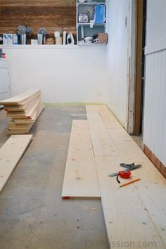 How to Update Concrete Floors for a Rustic Look Barn board floor over concrete tutorial