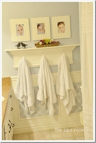 Love the idea of kids after bath pics in frames for the bathroom and hooks to coordinate with each one. Great way to teach kids to hang up their towels- and they dont have to read to know which one is theirs!  Also love the colors and wall decorations in this bathroom.