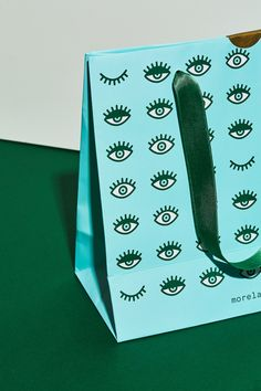 Morela rebranding on Behance Fashion Packaging, Cool Packaging, Brand Packaging, Paper Bag Design, Face Line Drawing, Tag Design, Graphic Design Tutorials, Shops, Packaging Design Inspiration