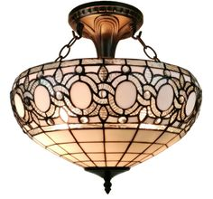 This Tiffany style lamp is hand-crafted using some of the same styles that were developed by Louis Comfort Tiffany at the turn of the last century. Create an elegant atmosphere in your home by simply