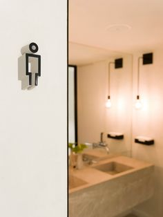 WC signage designed by Mucho for Spanish 5-star hotel Sant Francesc.
