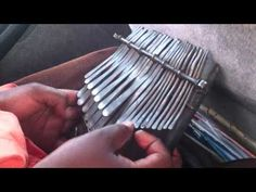 Africa   An mbira player in Zimbabwe, masterfully playing the instrument while singing along in Shona.
