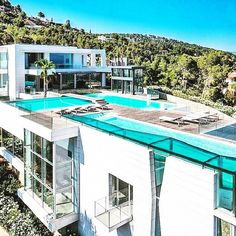 Modern mansion with a pool on the roof.