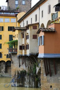 Florence Italy with details of Ponte Vecchio bridge!  Look at the colors and character of the homes and stores built right onto this bridge and still used today!  Travel photography image for sale at www.jhphotography.org