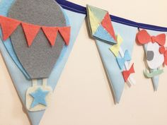 A personal favourite from my Etsy shop https://www.etsy.com/uk/listing/493299894/planes-and-hot-air-balloon-bunting