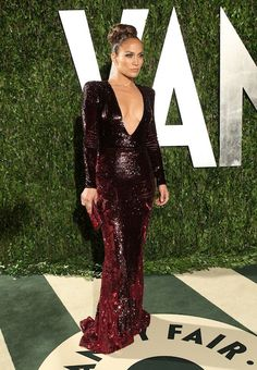 J. Lo in Zuhair Murad at Vanity Fair party. Hope she's wearing double stick tape!