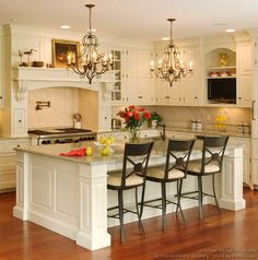 476 best Kitchen Islands images on Pinterest   Kitchen ideas     Luxurious Vintage White Kitchen Interior Design With White Huge Island And  White Cabinets Completed With Beige Marble Countertops And Three Black  Chairs And