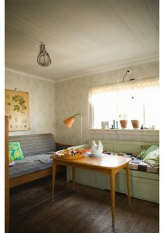 Sweet Scandinavian room; this reminds me of my neighbour's house, growing up.  I used to love sitting at the bench to eat!