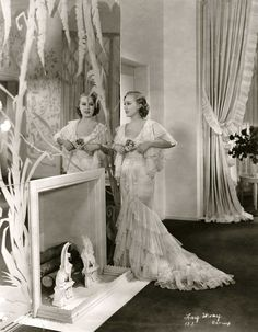Fay Wray, 1930s in beautiful lacy dres with tiered ruffles, a style feature of the 30s.