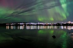 The Northern Lights sweeping across the city of Reykjavik