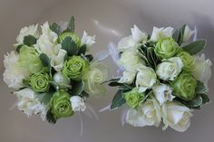 Wedding - Bridesmaid's Bouquets. Featuring green & white roses, variegated leaves and white feathers. www.uniqueweddingflowers.co.uk