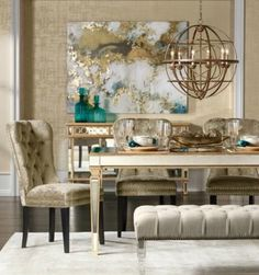 Glam dining room with mirrored buffet and dining table and large brass chandelier