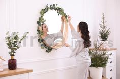 Woman decorating mirror with eucalyptus branches at home. Buy Creativity & Imagination. Take a look at what the world's best photographers have to offer at africa-images.com Eucalyptus Branches, What The World, Best Photographers, Photo Library, Imagination, Creativity, Africa, Stock Photos, Decorating