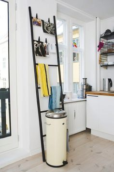 Ladder as a blanket rack... Or apron rack, towel rack, etc. I'd take out the dowel closets to the trash can though. Craft room rack, laundry room rack. The list goes on