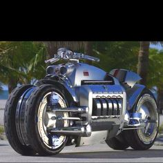 Dodge Tomahawk Motorcycle.  V-10. 500 horses. 9 in existence. 4 wheels.  0-60: 2.5 seconds. Top Speed: 300+.