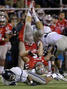UNLV tight end Taylor Barnhill is hit by Utah State linebacker Zach Vigil after being upended by cornerback Tay Glover-Wright Saturday. Football Hits, College Football, Football Reference, Tight End, Lsu, Alabama, Athletic, Utah, Boys