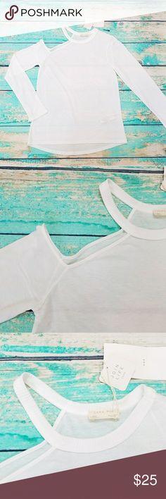 "ZARA Cold shoulder long sleeve white tee sz S NWT A twist on a basic. ZARA Cold shoulder long sleeve white tee sz S NWT.  18 inch armpit to armpit Front length: 23"" Back length: 25"" Sleeve length:24"" Zara Tops"