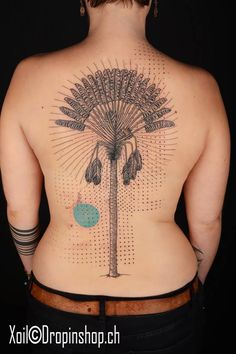 Graphic style tree tattoo on the back.