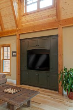 Built-in media center, finished in Farrow & Ball's Carriage Green