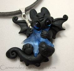 Star Cuddle Night Fury Necklace BLUE by TheWhiteMandara on Etsy, $32.00 it's eyes are sooooo big!