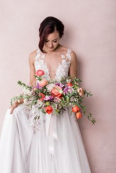 Colorful bridal shoot with bright florals- Bright and colorful bridal bouquet with tulips, garden roses, jamine vine, ginestra, ranunculus and snapdragon Floral: Wildflowers LLC Photo: Rebecca Denton Photography Wildflower Bridal Bouquets, Rose Bridal Bouquet, Spring Bouquet, Bride Bouquets, Flower Bouquets, Floral Wedding, Wedding Flowers, Bride Flowers, Boho Wedding