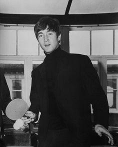 John Lennon playing ping pong