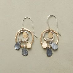 RAINY DAY EARRINGS--Sterling silver and 12kt gold filled drops send ripples into dangling puddles of the same two metals. Handcrafted exclusive