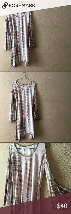 Gaya Gray Tie Dye Tunic This Tunic is absolutely amazing. Light gray tie dye//open shoulder cut outs//bohemian bell sleeves//scoop neck//generous length//95% Rayon; 5% Spandex//light weight and perfect for spring//this has never been worn Gaya Tops Tunics