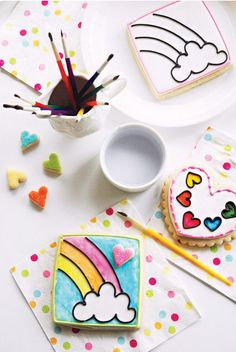 Create your own Paint by Party Cookies for any party theme! Rainbow cookies are painted at a Rainbow Party using heart shaped paint palette cookies