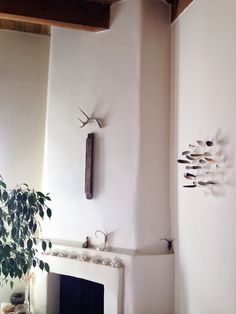 I really love the feathers floating on the wall, and want to figure out how to do that. ~ETS (Design*Sponge - Home Tour: Ja Soon Kim's house in New Mexico.)