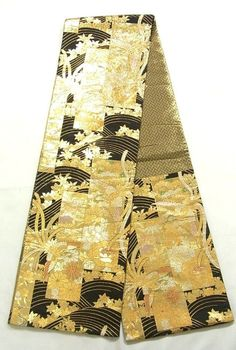 This is a graceful Fukuro obi with seasonal flowers and houou(phoenix) on 'tanzaku'(strip of paper) and wave pattern, which is woven