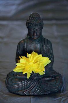 Beautiful Buddha with yellow flower