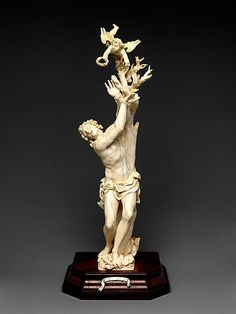 'Saint Sebastian'.The Fury Master (Austrian). Date: 17th century. Culture: Austrian, Salzburg. Medium: Ivory; kingwood socle. Dimensions: Overall: 17 1/2 in. (44.5 cm) (without wooden socle). -The Metropolitan Museum of Art, NY-