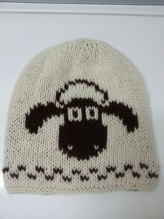 Shaun's Hat - Sheep Beanie pattern by Marianne Mueller A double knit reversible beanie with the beloved sheep Shaun on the front, and a few members of his herd on the back. Intarsia Knitting, Knitting Charts, Knitting Patterns Free, Free Knitting, Motifs Beanie, Sheep Fabric, Shaun The Sheep, Baby Hat Patterns, Knitting Projects
