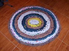 Picture of How to Make a Rug from Plastic Grocery Bags ~ found on Instructables with a full picture tutorial AND an adobe download! (PDF) ~ this entire project is genius!!!