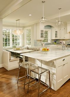 The cabinets are BM Decorators white. Bar stools are CB2. Wall color BM Grey Owl.