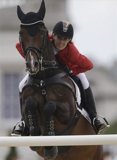 Germany's Janne Friederike Meyer rides Lambrasco during the equestrian third day of show jumping