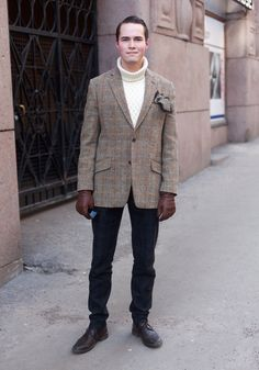 """Jalmari, 21  """"I'm wearing a jacket by Harris Tweed, a Wolsey knit, a pocket square by Stockholm Kravatt, trousers by Day and shoes by Cafe Noir. My style is classic British. The 20s and the 30s inspire me – when Europe was at its best."""" 2 March 2013, Fredrikinkatu"""