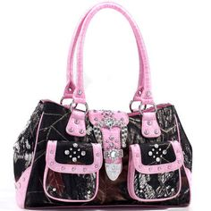 Trendy chic details like the optional snap gathered top and studded faux croc handles lend fashionable style to the go anywhere, do anything feel of this girl's best friend bag.MOSSY OAK PINK CAMO DOUBLE FRONT POCKET RHINESTONE BUCKLE PURSE $49.99 www.nanascountryrusticshop.com www.facebook.com/nanascountryrusticshop #MossyOak #camo #purse #handbag #newlylisted #nanascountryrusticshop #rhinestone #pink