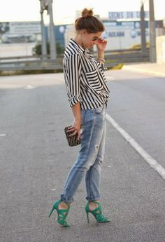 Stripes blouse with sky blue casual jeans and stylish clutch and bottle green stylish high heels sandals