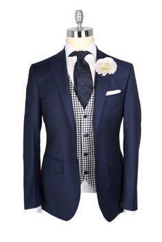 Navy Blazer + black white checkered vest + navy patterned tie