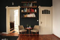 black wall and bookshelf in living room | craftifair.com