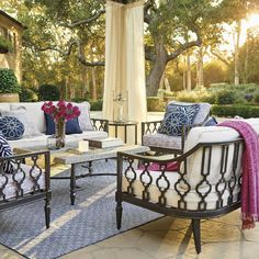The quatrefoil pattern recurring throughout the Avery seating set puts a contemporary twist on the antique iron gates you'd find in Europe.