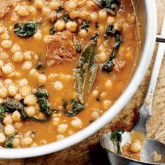 Chickpea Stew with Spinach and Chorizo | This stew, like all those in Catalonia, starts with a sofrito, a thick sauce made with sautéed onions and tomatoes. Once you get all the ingredients in the pot, there's not much to do besides enjoy the aroma wafting from this hearty, spicy, soupy stew as it slowly cooks.