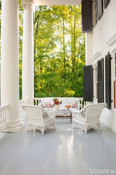 That's a porch! White Greek Revival porch with black shutters, large columns, wicker - Architectural renovation by Allan Greenberg; interior design by Amelia Handegan in Hot Springs, Virginia - Veranda Southern Porches, Southern Homes, Southern Charm, Southern Living, Southern Style, Southern Plantation Homes, Plantation Houses, Southern Mansions, Southern Plantations